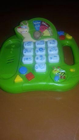 Продам развивающую интерактивную игрушку-телефон