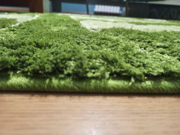 Sprzedam zielony dywan.