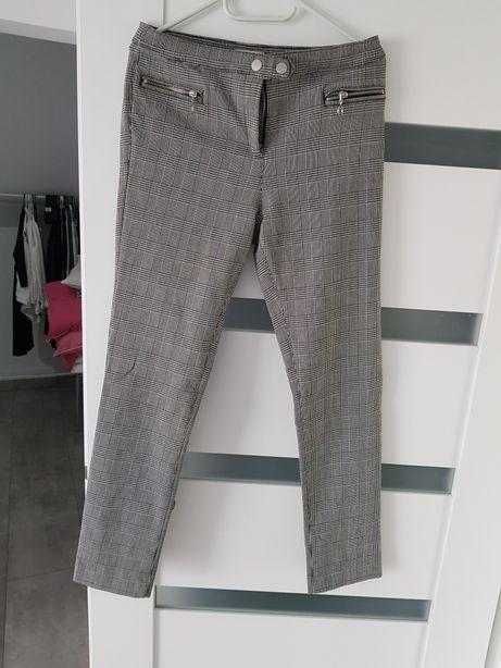 Spodnie w kratkę hm