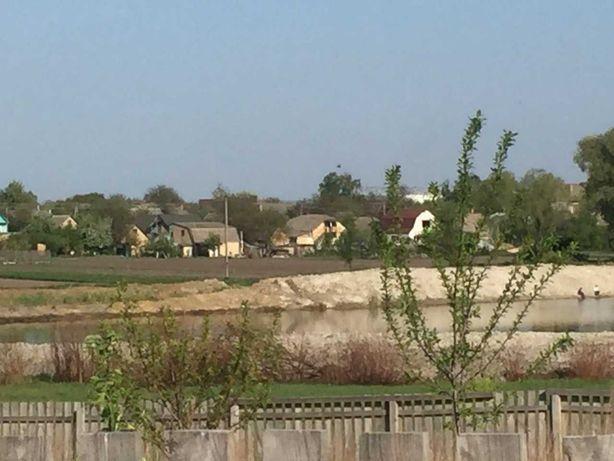 Бучанский район,  Блиставица участок 12 сот у озера, 20 км от Киева.