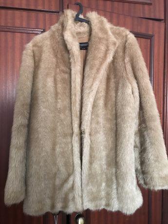 Varios casacos como novos