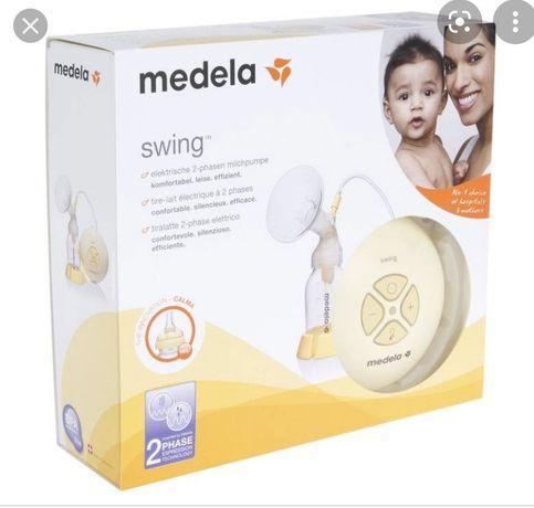 Молокоотсос Medela
