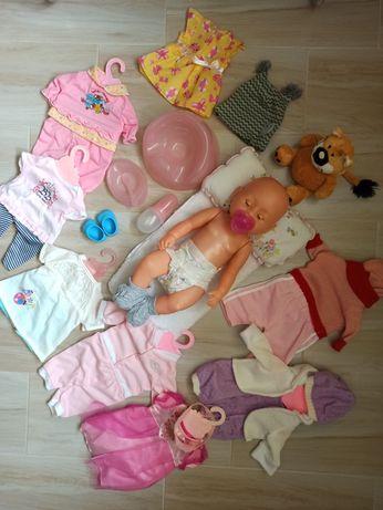 Кукла с одежками и кроватка