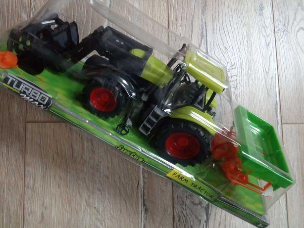 Traktor z maszyną NOWY