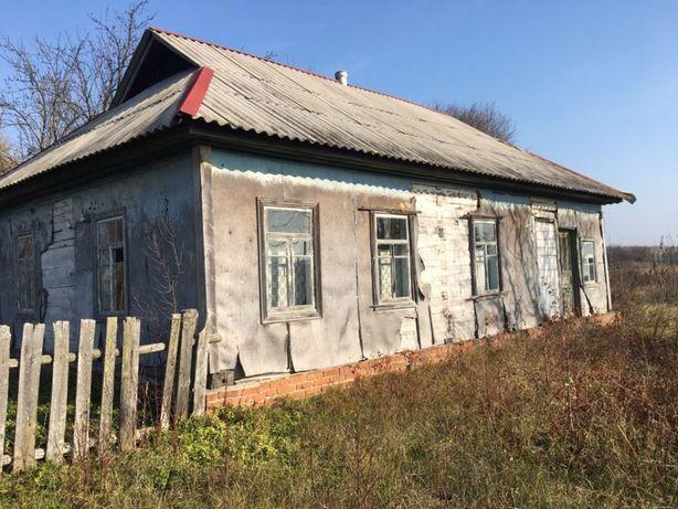 Продам земельний участок з будинком 0,5га.
