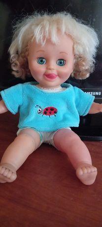 Кукла хохотушка.