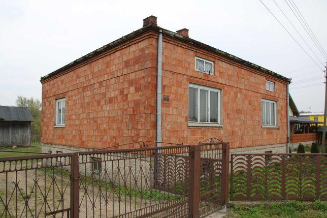 Siedlisko w gminie Sadkowice - grunt rolny zabudowany domem i las.