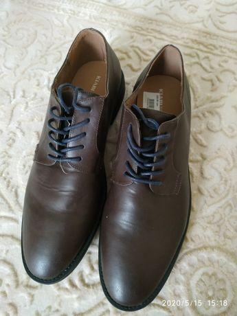 Чоловічі туфлі нові