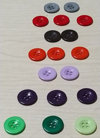 18 Botões de 21 mm.