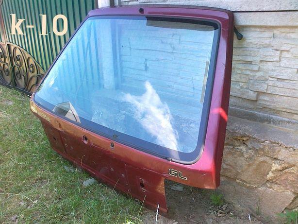 Крышка багажника ( ляда ) Ниссан Микра к-10 со стеклом