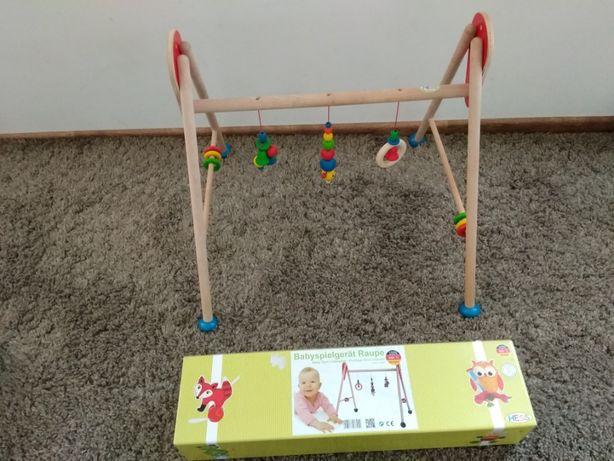 Drewniany stojak pałąk na zabawki baby gym HESS idealny stan