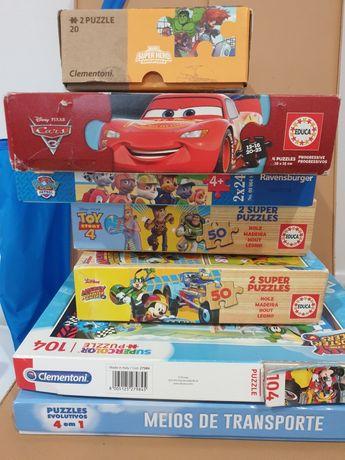 Puzzles infantis e saco brinquedos