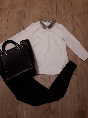 Elegancka biała bluzka z ozdobnym kołnierzem