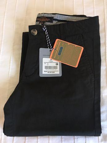 Calças Sacoor novas, com etiqueta, cor castanho, tamanho 12 anos