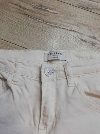 Sprzedam białe spodnie dziewczęce