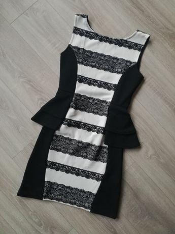 Sukienka z baskinką i koronką, modelująca, wyszczuplająca