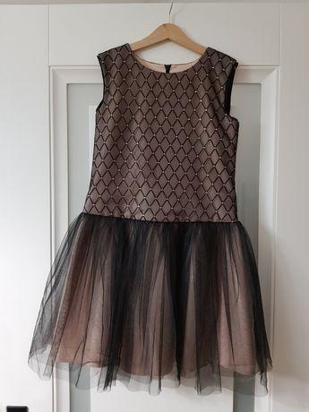 Śliczna sukienka na komunię 146