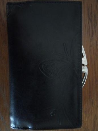 Продам кошелек, новый, кожаный.