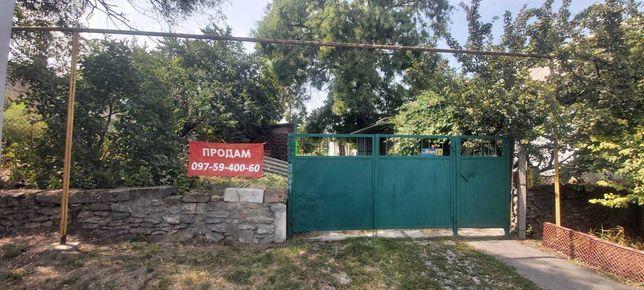 Продам участок 25 соток с домом на два хозяина в центре Малодолинского