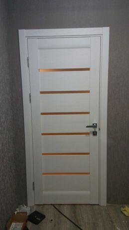 Установка дверей и укладка полов
