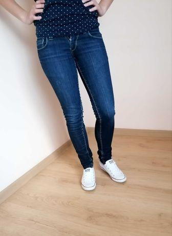 Granatowe jeansy XS skiny niski stan