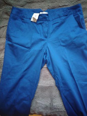 Spodnie Promod 42