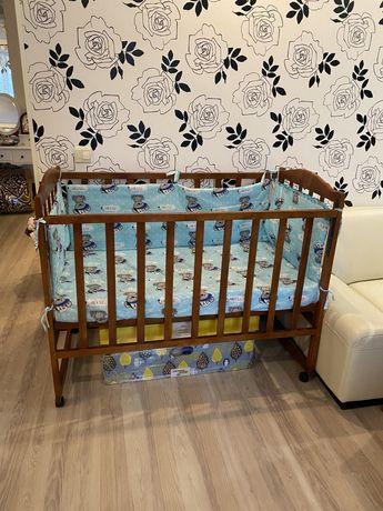 Продам новую детскую кроватку с откидным бортиком!