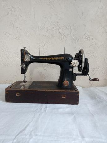 Швейная машинка ручная.