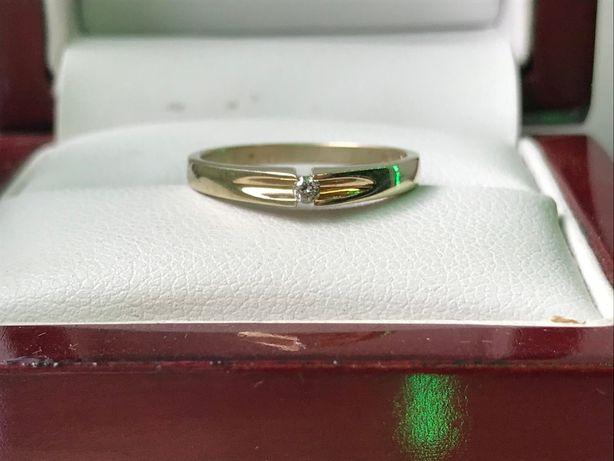 używany złoty pierścionek z diamentem 1,52g p585 r10 certyfikat