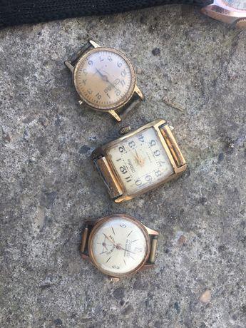 Старі механічні позолочені годинники Au
