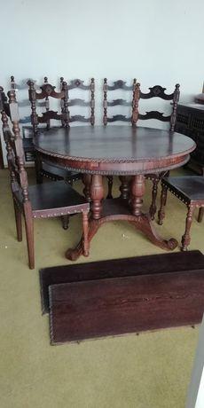 Mesa de refeições e oito cadeiras. Madeira Africana