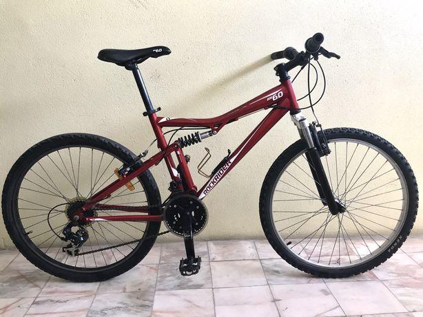 Bicicleta rockrider suspensão total