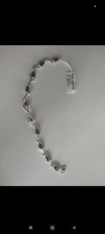 Srebrna bransoletka z niebieskimi dodatkami