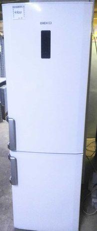 Двухкамерный, белый холодильник фирмы БЕКО. No Frost