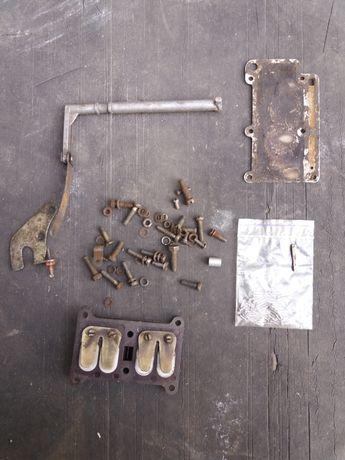 лепестковий клапан на лодочний мотор ветерок 8е