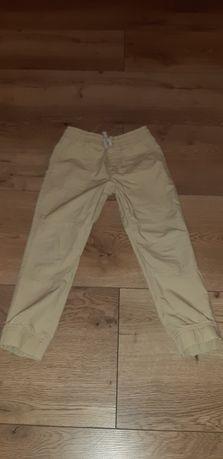 Kremowe spodnie roz.116/122