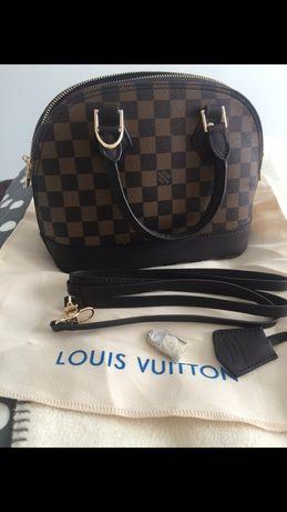 Louis Vuitton Alma kuferek