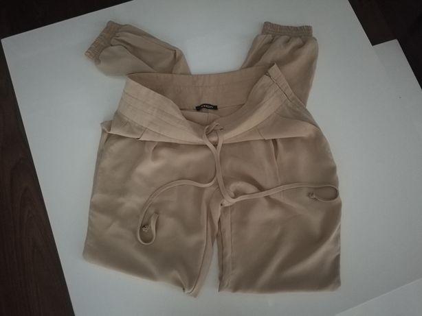 Morgan jasno beżowe cieliste spodnie wysoki stan alladynki