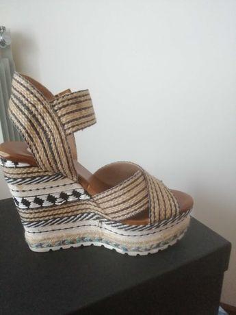 Sandálias em Cunha exe