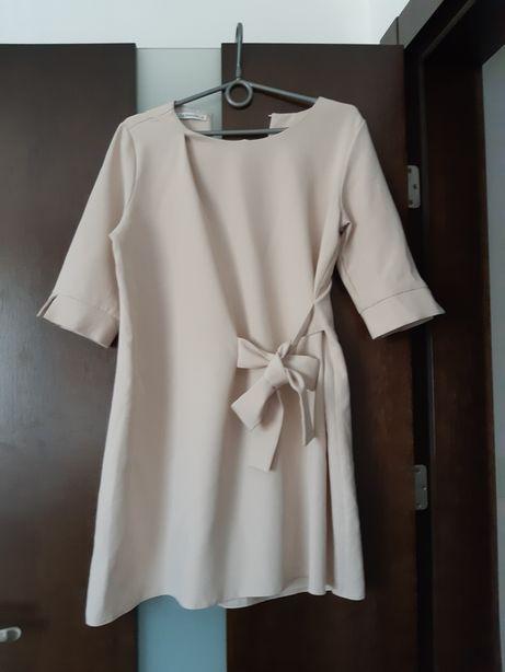 Beżowa sukienka 38