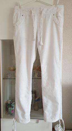 Biale spodnie bez zapięcia Atmosphere r. 36-38