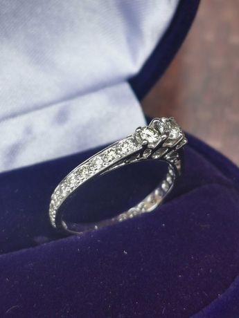 OKAZJA !!! Złoty pierścionek z brylantami 0,75ct.( z certyfikatem )