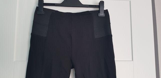 Zara czarne tregginsy L 40