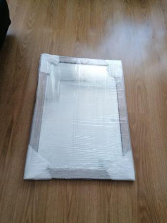 Vendo espelho novo cinza prata