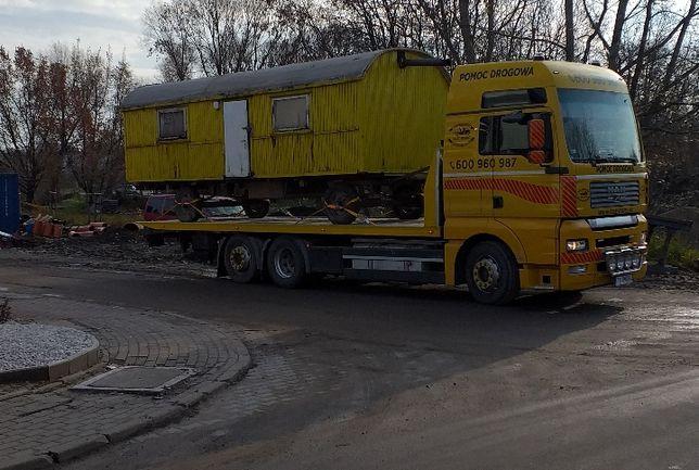 Laweta transport wózków widłowych koparek maszyn Poznań Niskopodwozie
