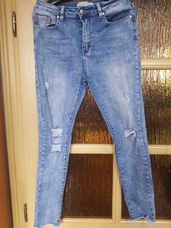 Spodnie jeans z przetarciami rozm.M