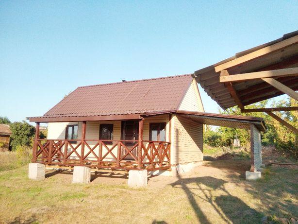 Продам дом с земельным участком на берегу реки
