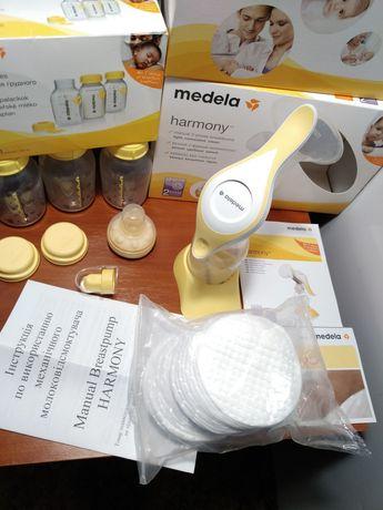 Молокоотсос Medela Harmony+ три бутылочки