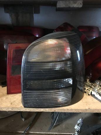 Lampy hella black czrne audi a6 c5 a4 b5 sedan avant tył tylne komplet