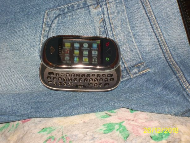 Мобильный телефон Alcatel OneTouch 880 слайдер